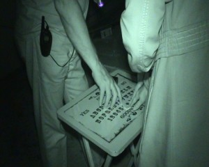 Guests using Ouija board